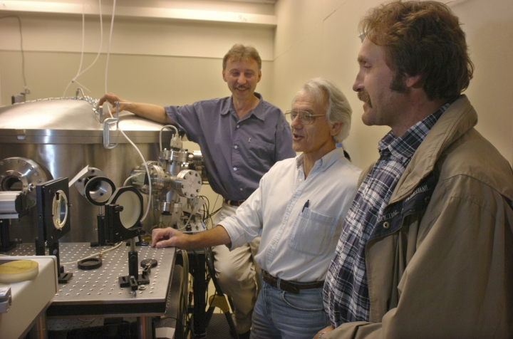 FILE - In this Monday, June 28, 2004 file photo, University of Michigan Professor Gerard Mourou, center, and fellow research scientists Anatoly Makisimchuk, left, and Victor Yanovsky talk about the potential of the laser dubbed Hercules that has been built over the past five years at the University of Michigan lab. American Arthur Ashkin, Canadian Donna Strickland, and French scientist Gerard Mourou win the 2018 Nobel Prize for work in laser physics. (AP Photo/The Ann Arbor News, Robert Chase, File)