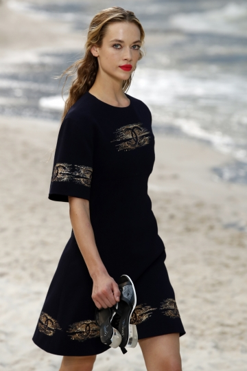 A model wears a creation for Chanel Spring/Summer 2019 ready-to-wear fashion collection in Paris, Tuesday, Oct.2, 2018. (AP Photo/Christophe Ena)