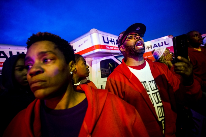 Protesters shout out at the police as they work to get several people into ambulances safely after a truck collided with into protesters calling for the right to form unions Tuesday, Oct. 2, 2018, in Flint, Mich. Police said the collision appears to be an accident. (Jake May/The Flint Journal via AP)