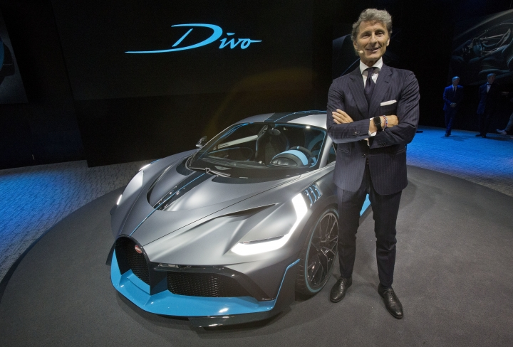 President of Bugatti Automobiles S.A.S. Stephan Winkelmann poses next to a 5 million euro (5.8 $) Bugatti Divo during a media presentation on the eve of Paris Auto Show in Paris, Monday, Oct. 1, 2018. Doubts about diesel, Brexit, trade worries, tighter emissions controls. Those are the challenges that will be on the minds of auto executives when they gather this week ahead of the Paris Motor Show at the Porte de Versailles exhibition center. (AP Photo/Michel Euler)