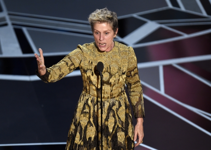 """FILE - In this March 4, 2018 file photo, Frances McDormand talks about inclusion riders as she accepts the award for best performance by an actress in a leading role for """"Three Billboards Outside Ebbing, Missouri"""" at the Oscars in Los Angeles. A year after the Harvey Weinstein allegations first surfaced, Hollywood is still sifting through the wreckage. For many, the Weinstein case laid bare the movie industry's systemic gender inequalities. Last month, Warner Bros. became the first major studio to make a similar pledge. Many prominent film festival directors have also signed agreements to push their executive boards to gender parity. (Photo by Chris Pizzello/Invision/AP, File)"""