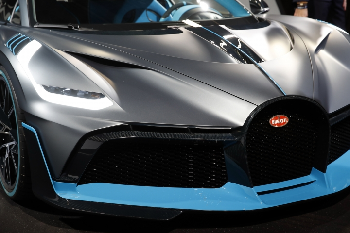 A Bugatti Divo is on display at the Auto show in Paris, France, Wednesday, Oct. 3, 2018, 2018. All-electric vehicles with zero local emissions are among the stars of the Paris auto show, rubbing shoulders with the fossil-fuel burning SUVs that many car buyers love. (AP Photo/Christophe Ena)