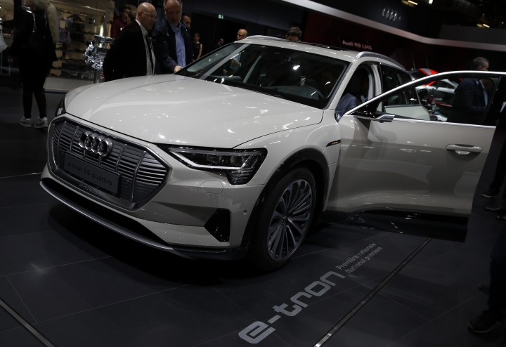 An Audi e-tron 55 quattro is on display at the Auto show in Paris, France, Wednesday, Oct. 3, 2018, 2018. All-electric vehicles with zero local emissions are among the stars of the Paris auto show, rubbing shoulders with the fossil-fuel burning SUVs that many car buyers love. (AP Photo/Christophe Ena)