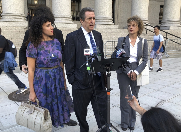 From left, Kristine Rakowsky, civil rights lawyer Norman Siegel,and Liane Nikitovich, meet with reporters outside federal court in New York on Wednesday, Oct. 3, 2018. The women filed a lawsuit arguing they should not be compelled to receive emergency alerts from the government on their phones. (AP Photo/Ted Shaffrey)