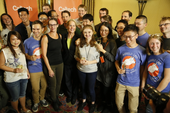 Nobel chemistry winner Frances Arnold, center, takes a photo with her Caltech Arnold Lab students at California Institute of Technology in Pasadena, Calif., Wednesday, Oct. 3, 2018. (AP Photo/Damian Dovarganes)