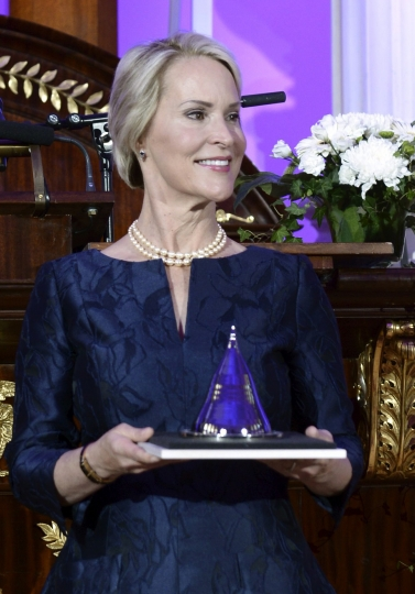 FILE - In this Tuesday, May 24, 2016 file photo, US biochemical engineer Frances Arnold, receives the Millennium Technology Prize 2016 during the awards ceremony in Helsinki, Finland. Frances Arnold, US, George P Smith, US, and Gregory P Winter of Britain have been awarded the 2018 Nobel Prize in Chemistry. (Heikki Saukkomaa/Lehtikuva via AP)