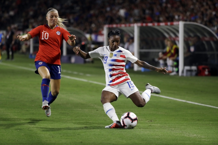FILE - In this Aug. 31, 2018, file photo, United States' Crystal Dunn, right, prepares to strike the ball during the second half of an international friendly soccer match in Carson, Calif. Dunn is pragmatic about her shifting roles: Whatever helps get the U.S. women's national team to next year's World Cup in France is fine with her. Dunn plays midfielder for the North Carolina Courage, which just won the National Women's Soccer League championship after a record breaking season. On Thursday, she moves to defense when national team opens the CONCACAF World Cup qualifying tournament with a match against Mexico in Cary, N.C. (AP Photo/Marcio Jose Sanchez, File)