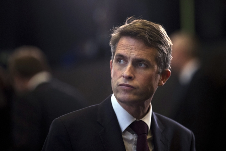 "Britain's Defence Minister Gavin Williamson stands in the main chamber during the second day of a meeting of the North Atlantic Council at a gathering of NATO defence ministers at NATO headquarters in Brussels, Thursday, Oct. 4, 2018. British Defence Secretary Gavin Williamson on Thursday branded a series of global cyberattacks blamed on Russia as the reckless actions of a ""pariah state"" and said that Britain and its NATO allies would expose such actions in the future. (AP Photo/Francisco Seco)"