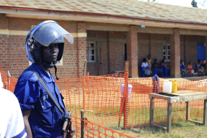 FILE - In this Friday, Aug. 10, 2018 file photo, a police officer stand guards at a newly established Ebola response center in Beni, Democratic Republic of Congo. The international community is sounding new alarm after three Red Cross workers were attacked while trying to contain the latest deadly Ebola outbreak in Congo. The U.N. Security Council seeks an immediate end to hostilities as it leaves for a Congo visit on Thursday, Oct. 4. Armed groups are active in the region and fearful residents have been aggressive toward health workers. (AP Photo/Al-hadji Kudra Maliro, file)