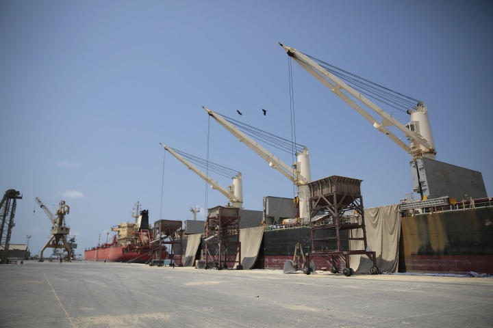 In this Saturday, Sept. 29, 2018 photo, cargo ship and oil tanker ship are idle at the port of Hodeida, Yemen. With US backing, the United Arab Emirates and its Yemeni allies have restarted their all-out assault on Yemen's port city of Hodeida, aiming to wrest it from rebel hands. Victory here could be a turning point in the 3-year-old civil war, but it could also push the country into outright famine. Already, the fighting has been a catastrophe for civilians on the Red Sea coast. (AP Photo/Hani Mohammed)