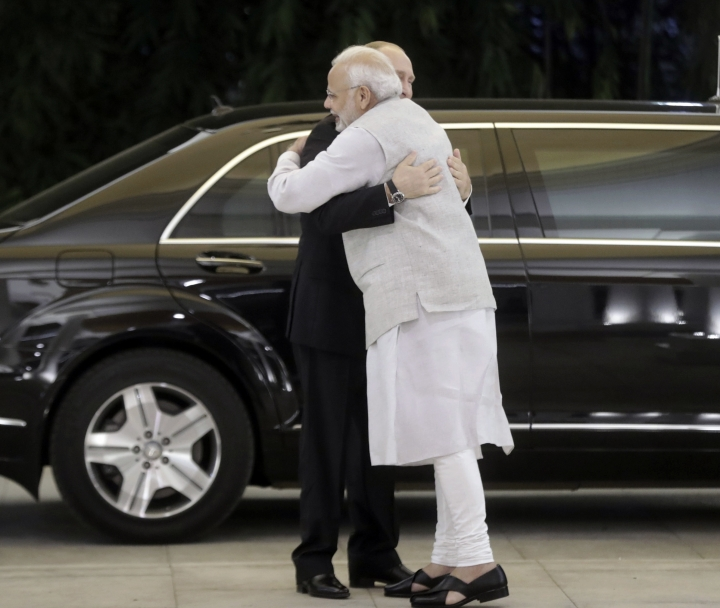 Russian President Vladimir Putin, left, and Indian Prime Minister Narendra Modi greet each other prior to their talks in New Delhi, India, Thursday, Oct. 4, 2018. Putin arrived in India on Thursday for a two-day visit during which India is expected to sign a $5 billion deal to buy Russian S-400 air defense systems despite a new U.S. law ordering sanctions on any country trading with Russia's defense and intelligence sectors. (Mikhail Metzel, Sputnik, Kremlin Pool Photo via AP)