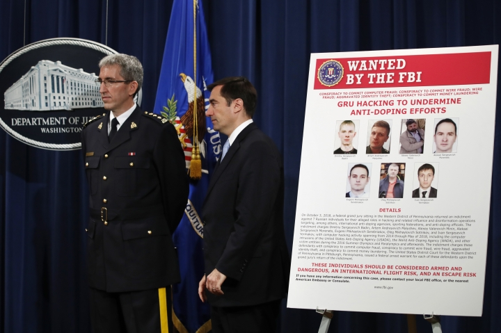 Mark Flynn, Director General for the Royal Canadian Mounted Police, left, and Assistant Attorney General for National Security John Demers, attend a news conference, Thursday, Oct. 4, 2018, at the Justice Department in Washington. (AP Photo/Jacquelyn Martin)
