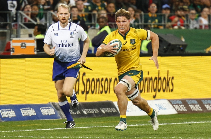 Australia's Michael Hooper makes a run with the ball the rugby test match against South Africa, in Port Elizabeth, South Africa, Saturday, Sept. 29, 2018. (AP Photo)