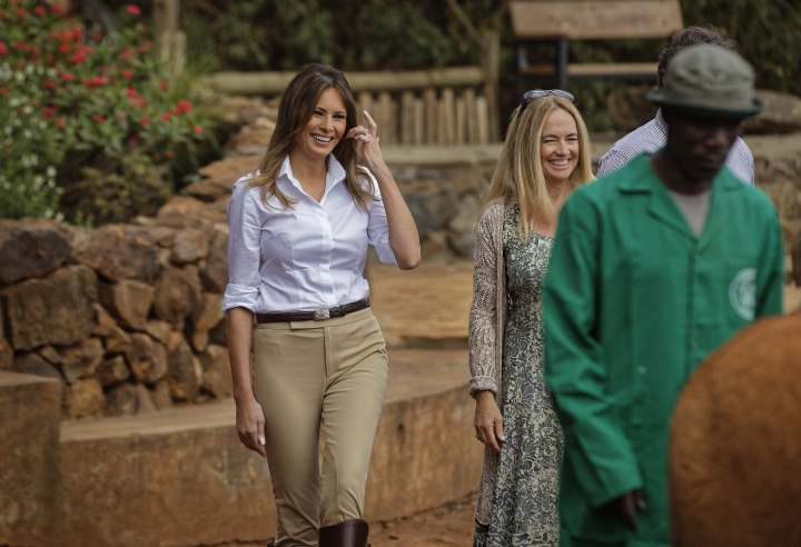 U.S. first lady Melania Trump laughs with CEO Angela Sheldrick, right, after Mrs Trump was nudged by a baby elephant she petted, at the David Sheldrick Wildlife Trust elephant orphanage in Nairobi, Kenya Friday, Oct. 5, 2018. Trump took part in a baby elephant feeding on Friday as she visited a national park in Kenya to highlight conservation efforts. Kenya is the third stop on her Africa tour, which began Tuesday in Ghana and continued in Malawi on Thursday. (AP Photo/Ben Curtis, Pool)