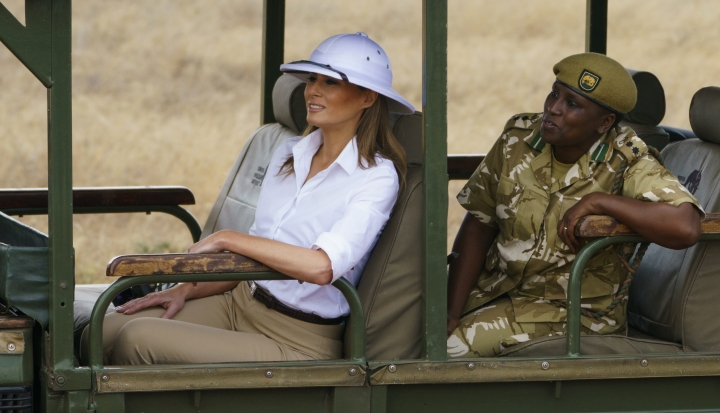 First lady Melania Trump looks out over Nairobi National Park in Nairobi, Kenya, Friday, Oct. 5, 2018, during a safari guided by Nelly Palmeris. Melania Trump has fed baby elephants as she visits a national park in Kenya to highlight conservation efforts. The U.S. first lady also went on a quick safari. Mrs. Trump is on her first-ever visit to Africa and her first extended solo international trip as first lady. (AP Photo/Carolyn Kaster)