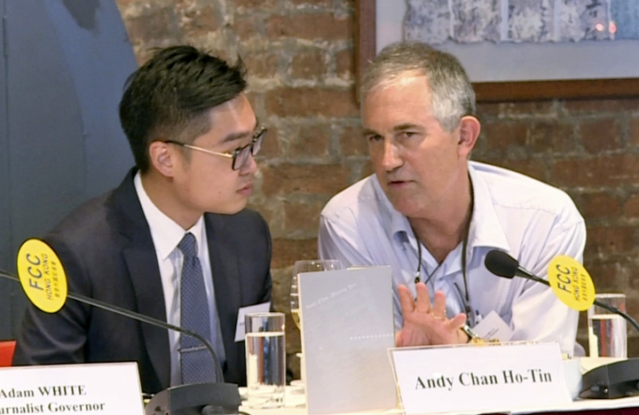 In this Aug. 14, 2018, image made from a video, The Financial Times Asia news editor, Victor Mallet, right, speaks with Andy Chan, founder of the Hong Kong National Party, during a luncheon at the Foreign Correspondents Club in Hong Kong. The Financial Times said Friday, Oct. 5, 2018 that Hong Kong's government has refused to renew the work visa of Mallet, in what human rights activists say is the latest sign of a deteriorating human rights situation in the semi-autonomous Chinese territory. (Pool video via AP)