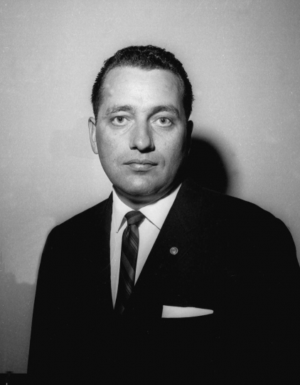 FILE - In this Dec. 3, 1963 file photo, U.S. Secret Service Special Agent Clinton J. Hill poses in Washington. Hill who famously used his body to shield first lady Jacqueline Kennedy the day President John F. Kennedy was assassinated will receive the highest honor bestowed by his home state of North Dakota. The former agent will receive the Theodore Roosevelt Rough Rider Award during a future ceremony, Gov. Doug Burgum announced Friday, Oct. 5, 2018. (AP Photo/Robert H. Shutz File)