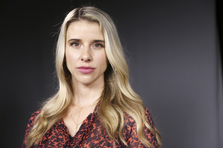 """In this Friday, Oct. 5, 2018 photo, Melissa Schuman poses for a photo in Los Angeles. The #MeToo movement has sent dozens of once-powerful Hollywood players into exile, but few of them have been placed in handcuffs or jail cells. And it's increasingly apparent that the lack of criminal charges may remain the norm. """"For me it was not necessarily closure, but one of the healthiest things I've ever done for myself,"""" said Schuman, whose case dating to 2003 against Nick Carter of the Backstreet Boys was rejected over the statute of limitations. (AP Photo/Reed Saxon)"""
