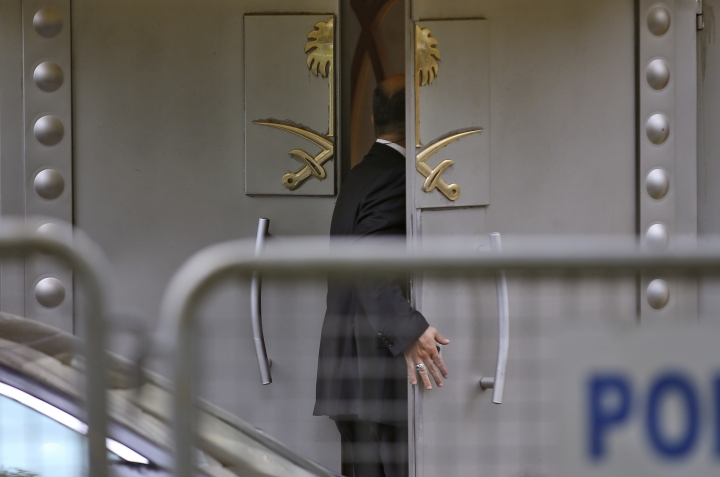 A security guard enters the Saudi Arabia consulate in Istanbul, Thursday, Oct. 4, 2018. Saudi Arabia's Consulate in Istanbul insisted Thursday that Jamal Khashoggi, a missing Saudi contributor to The Washington Post, left its building before disappearing, directly contradicting Turkish officials who say they believe the writer is still inside. (AP Photo/Emrah Gurel)