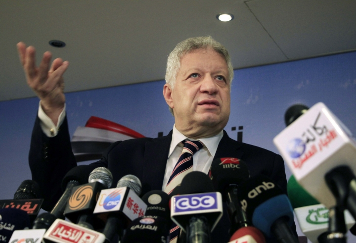 FILE - In this April 6, 2014 file photo, Murtada Mansour, lawyer and chairman of Zamalek FC, speaks during a press conference in Cairo, Egypt. Mansour, chairman of Al-Ahly's archrival, has gained notoriety with vulgar outbursts, but there has been an attempt to curb his behavior by the Confederation of African Football and the Egyptian Olympic Committee with sanctions imposed. Mansour threatened to burn down CAF's Cairo headquarters. (AP Photo/Lobna Tarek, El Shorouk, File)