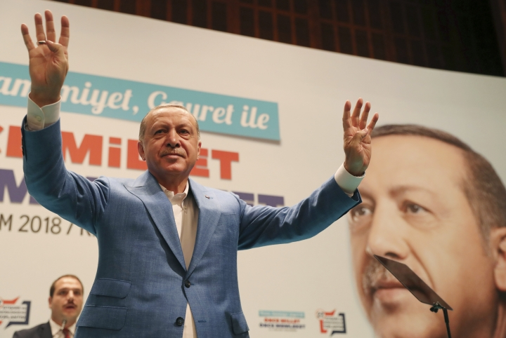 "Turkey's President Recep Tayyip Erdogan waves to supporters of his ruling Justice and Development Party (AKP), during a rally in Kizilcahamam, central Turkey, Sunday, Oct. 7, 2018. When asked by journalists about Saudi writer Jamal Khashoggi, who vanished Tuesday while on a visit to the consulate, Erdogan only said ""God willing, we will not be faced with the situation we do not desire"". (Presidential Press Service via AP, Pool)"