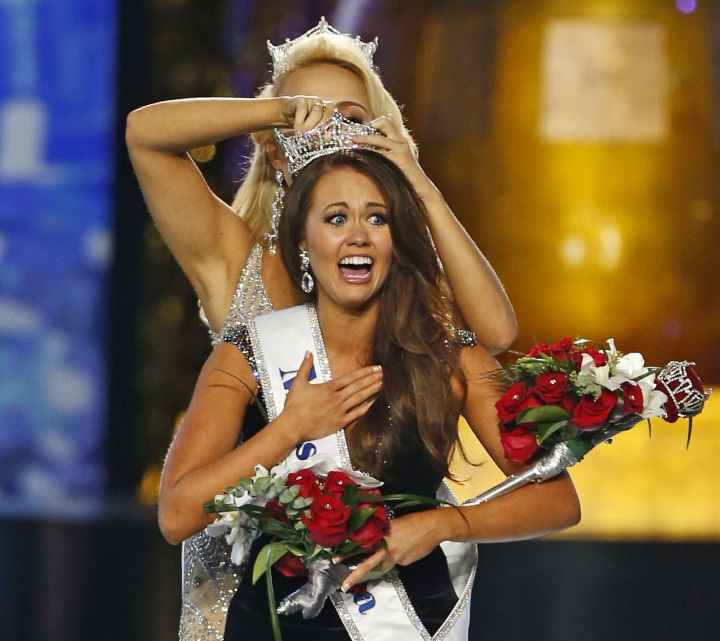 FILE – In this Sept. 10, 2017, file photo, Miss North Dakota Cara Mund reacts after being named Miss America during the Miss America 2018 pageant in Atlantic City, N.J. The Miss America Organization is striking back against state pageant groups who revolted against the national leadership in the run-up to this year's competition. The national group has revoked the licenses of four states, threatened at least 15 with probation, and thanked others who supported the pageant's leadership, headed by former Fox News host Gretchen Carlson. (AP Photo/Noah K. Murray, File)