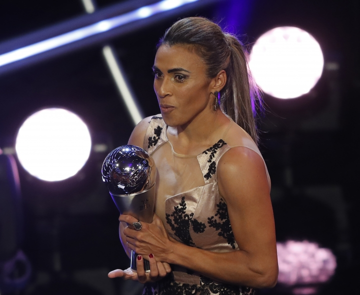 Brazil's Marta receives the Best FIFA Women's player award during the ceremony of the Best FIFA Football Awards in the Royal Festival Hall in London, Britain, Monday, Sept. 24, 2018. (AP Photo/Frank Augstein)