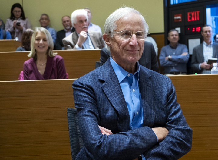 Yale University Professor William Nordhaus, one of the 2018 winners of the Nobel Prize in economics, listens to other speakers before commenting about the honor Monday, Oct. 8, 2018, in New Haven, Conn. Nordhaus was named for integrating climate change into long term macroeconomic analysis. (AP Photo/Craig Ruttle)