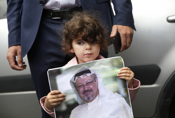 A girl holds a poster with a photo of missing Saudi writer Jamal Khashoggi, during a protest near the Saudi Arabia consulate in Istanbul, Monday, Oct. 8, 2018. Khashoggi, 59, went missing on Oct 2 while on a visit to the consulate in Istanbul for paperwork to marry his Turkish fiancée. The consulate insists the writer left its premises, contradicting Turkish officials. He had been living since last year in the U.S. in a self-imposed exile, in part due to the rise of Prince Mohammed, the son of King Salman. (AP Photo/Lefteris Pitarakis)