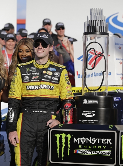 Ryan Blaney poses with the trophy in Victory Lane after winning the NASCAR Cup series auto race at Charlotte Motor Speedway in Concord, N.C., Sunday, Sept. 30, 2018. (AP Photo/Chuck Burton)