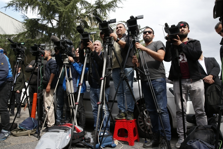 Members of he media cover a news announcement/protest by activists, members of the Human Rights Association Istanbul branch, in support of the missing Saudi journalist Jamal Khashoggi, near the Saudi Arabia consulate in Istanbul, Tuesday, Oct. 9, 2018. Turkey said Tuesday it will search the Saudi Consulate in Istanbul as part of an investigation into the disappearance of Jamal Khashoggi, a missing Saudi contributor to The Washington Post, a week after he vanished during a visit there. (AP Photo/Lefteris Pitarakis)
