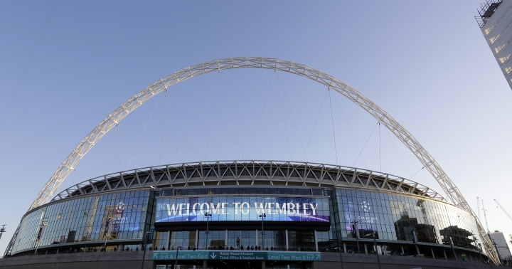 A view of the exterior of Wembley Stadium in London, Wednesday, Oct. 3, 2018. Britain is looking to host up to 60 major sporting events over the next 15 years, including soccer's World Cup, to assert global influence and secure trade deals after Brexit. Building on the successful of the 2012 Olympics in London and the English Premier League, hosting major sporting events is now embraced as a key instrument of soft power by British Prime Minister Thresa May's government. The UK Sport list of sporting events being targeted was revealed hours after May's speech to her Conservative Party conference, with the centerpiece the 2030 World Cup. (AP Photo/Kirsty Wigglesworth)
