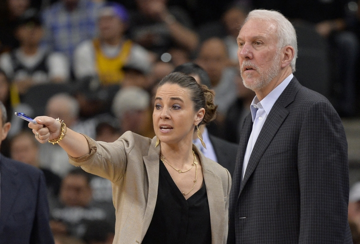 FILE - In this Feb. 6, 2016, file photo, San Antonio Spurs assistant coach Becky Hammon, left, talks to Spurs head coach Gregg Popovich, right, on the court during a timeout in the second half of an NBA basketball game against the Los Angeles Lakers in San Antonio. Popovich sees one simple way for both the NBA and women to mark real progress in the league: hire more women in positions of power. (AP Photo/Darren Abate, File)