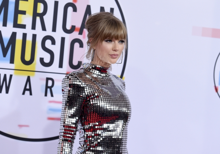 Taylor Swift arrives at the American Music Awards on Tuesday, Oct. 9, 2018, at the Microsoft Theater in Los Angeles. (Photo by Jordan Strauss/Invision/AP)