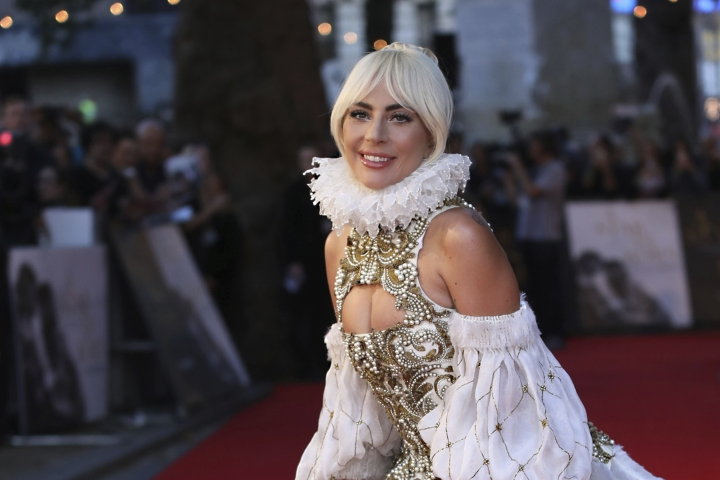 "FILE - In this Sept. 27, 2018, file photo, actress and singer Lady Gaga poses for photographers upon arrival at the premiere of the film ""A Star Is Born"" in London. Next year's Met Gala theme will be 'camp,' organizers revealed Tuesday, Oct. 9. It's a shift in tone and content from this year's meditation on Catholicism. The celebrity co-chairs will include Lady Gaga, Serena Williams and Harry Styles, along with Gucci designer Alessandro Michele and Vogue editor Anna Wintour. (Photo by Vianney Le Caer/Invision/AP, File)"