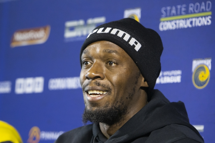 FILE - In this Aug. 21, 2018, file photo, Jamaica's Usain Bolt speaks at his press conference with the Central Coast Mariners soccer team in Newcastle, Australia. Bolt says his performance in a trial match could determine his future with the Central Coast Mariners in the A-League and his attempt to play professional football in general. (AP Photo/Steve Christo, File)