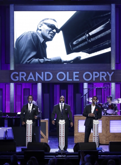 """In this Oct. 8, 2018, photo, Boyz II Men perform during """"An Opry Salute to Ray Charles"""" at the Grand Ole Opry House in Nashville, Tenn. (AP Photo/Mark Humphrey)"""
