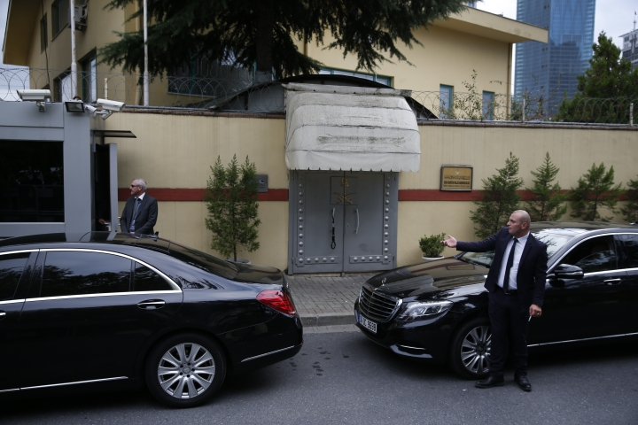 Security guards stand outside the Saudi Arabia's consulate in Istanbul, Tuesday, Oct. 9, 2018. Turkey said Tuesday it will search the consulate as it investigates why journalist Jamal Khashoggi, a contributor to the Washington Post, vanished there Oct. 2, an extraordinary probe of a diplomatic post amid Turkish officials' fears the writer had been killed inside the building. Saudi officials said he left the building unharmed.(AP Photo/Lefteris Pitarakis)