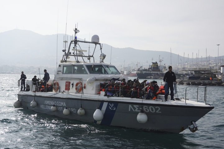 In this Jan. 31, 2016 photo Lieutenant Kyriakos Papadopoulos steers the Hellenic Coastguard boat into the Mytilene port , bringing in dozens of refugees and migrants that were trying to cross from Turkey coast to the Greek island of Lesbos. Greek authorities says that Papadopoulos credited with saving thousands of lives off the eastern Aegean island of Lesbos at the height of Europe's migration crisis has died aged 44. (AP Photo/Nikolia Apostolou)