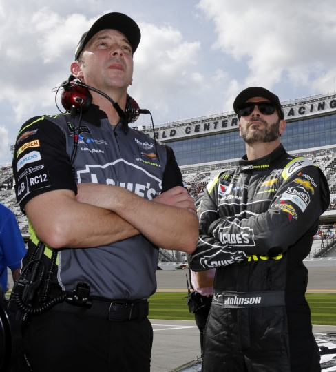 FILE - In this Feb. 11, 2018, file photo, Crew chief Chad Knaus, left, and Jimmie Johnson watch the leaderboard during qualifying for the NASCAR Daytona 500 auto race at Daytona International Speedway, Sunday,, in Daytona Beach, Fla. There will be no eighth NASCAR title for Johnson and Knaus. Hendrick Motorsports will split the driver and crew chief at the end of this season, the team announced Wednesday, Oct. 10, 2018. (AP Photo/Terry Renna, File)