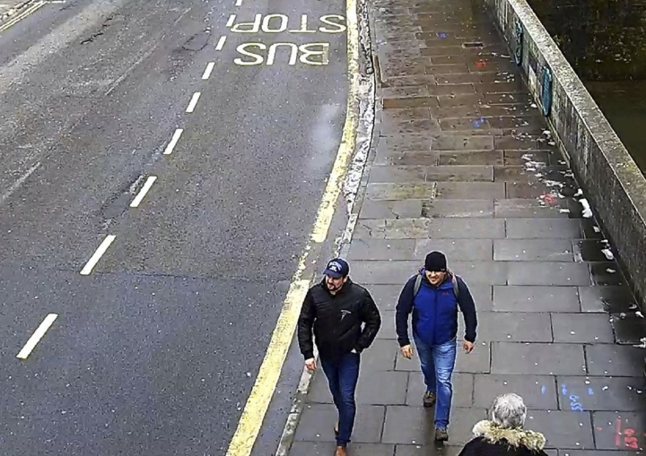 FILE - In this file grab taken from CCTV and issued by the Metropolitan Police in London on Wednesday Sept. 5, 2018, shows men identified as Ruslan Boshirov and Alexander Petrov walking on Fisherton Road, Salisbury, England on March 4, 2018. Investigative group Bellingcat reported Monday Oct. 8, 2018 on its website that the man British authorities identified as Alexander Petrov is actually Alexander Mishkin, a doctor working for the Russian military intelligence unit known as GRU. The other suspect in the March nerve agent attack on Sergei Skripal and his daughter in Salisbury, England, — Ruslan Boshirov. — is a decorated Russian agent named Anatoliy Chepiga, Bellingcat reported last month. (Metropolitan Police via AP, File)