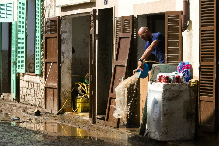 A man removes water and mud from his house affected by flooding in Sant Llorenc, Mallorca, Spain, on Thursday, Oct. 11, 2018. Spanish rescuers have found the bodies of a German couple that went missing after a destructive flash flooding that killed at least 10 more earlier this week in Mallorca and are still looking for a missing child. (AP Photo/Francisco Ubilla)