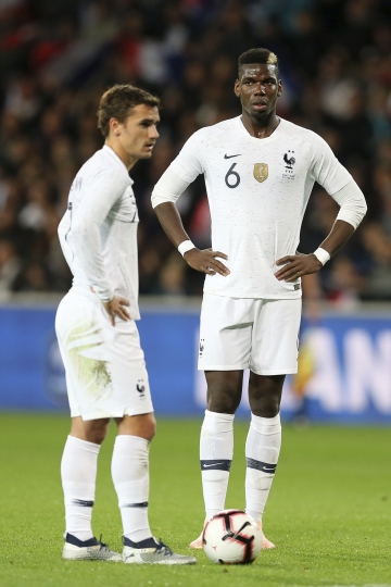 France's Antoine Griezmann, and Paul Pogba stand prior to shoot a free kick during a friendly soccer match between France and Iceland, in Guingamp, western France, Thursday, Oct. 11, 2018. (AP Photo/David Vincent)