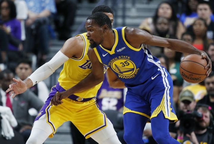 Golden State Warriors forward Kevin Durant drives against Los Angeles Lakers guard Josh Hart during the first half of an NBA preseason basketball game Wednesday, Oct. 10, 2018, in Las Vegas. (AP Photo/John Locher)