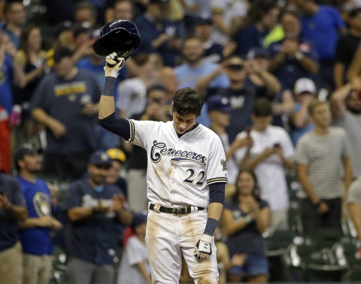 FILE - In this Monday, Sept. 17, 2018, file photo, Milwaukee Brewers' Christian Yelich reacts after receiving a standing ovation from the crowd after hitting a triple to complete the cycle during the sixth inning of a baseball game against the Cincinnati Reds, in Milwaukee. When Yelich takes the field against the Los Angeles Dodgers, he'll have one group of Milwaukee fans rooting especially loud for his success: Serbian-Americans. (AP Photo/Aaron Gash, File)