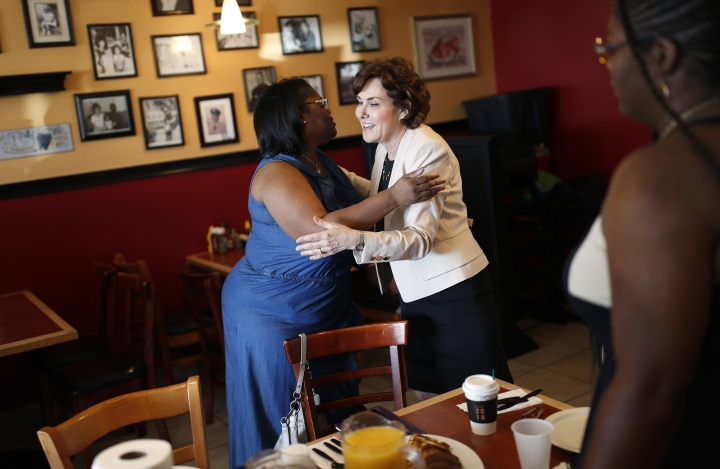 In this Sept. 29, 2018, photo, Rep. Jacky Rosen, D-Nev., right, embraces Carmen West during a breakfast event at TC's Rib Crib as she campaigns in Las Vegas. In the high-stakes race for Senate in Nevada, Rosen is taking on one of the biggest names in GOP politics by painting Sen. Dean Heller as someone without firm principles. (AP Photo/John Locher)
