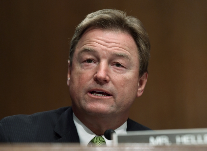 FILE - In this Jan. 30, 2018 file photo, Sen. Dean Heller, R-Nev., speaks during a Senate Banking Committee hearing on Capitol Hill in Washington. In the high-stakes race for Senate in Nevada, Democrat Jacky Rosen is taking on one of the biggest names in GOP politics by painting Sen. Dean Heller as someone without firm principles. (AP Photo/Susan Walsh, file)