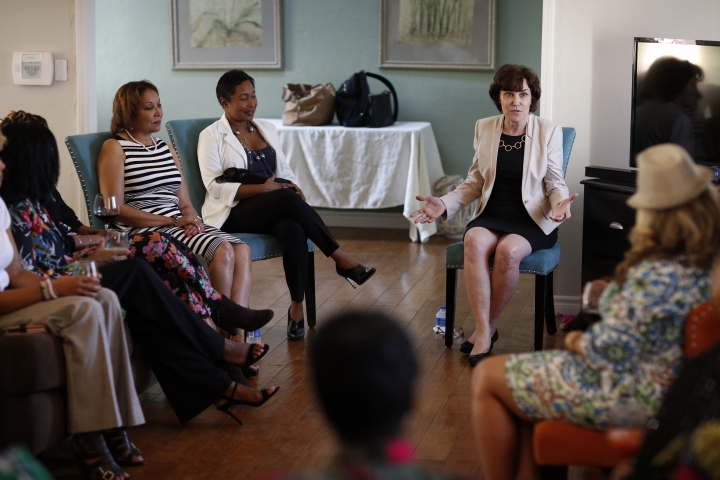 In this Sept. 29, 2018, photo, Rep. Jacky Rosen, D-Nev., center right, speaks at the home of Adrienne N. Hester, center left, as she campaigns in Las Vegas. In the high-stakes race for Senate in Nevada, Rosen is taking on one of the biggest names in GOP politics by painting Sen. Dean Heller as someone without firm principles. (AP Photo/John Locher)