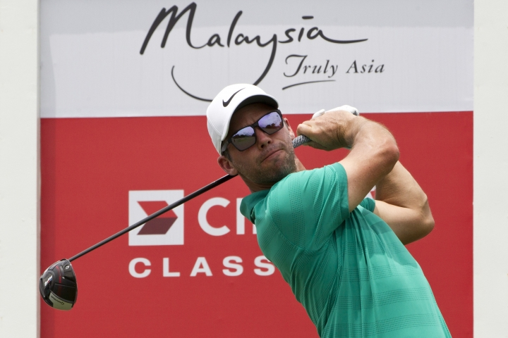 Paul Casey of England follows his shot on the eighteenth hole during round two of the CIMB Classic golf tournament at Tournament Players Club (TPC) in Kuala Lumpur, Malaysia, Friday, Oct. 12, 2018. (AP Photo/Yam G-Jun)