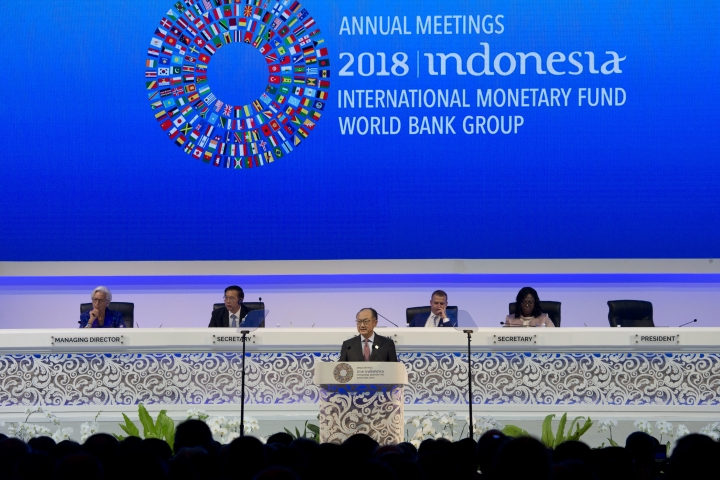 World Bank President Jim Yong Kim, foreground, delivers his speech during the opening of International Monetary Fund (IMF) World Bank annual meetings in Bali, Indonesia on Friday, Oct. 12, 2018. (AP Photo/Firdia Lisnawati)